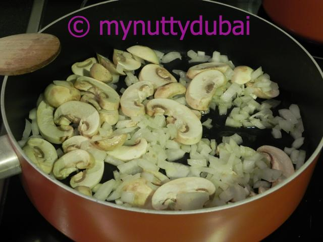 Frying up the mushrooms and onion