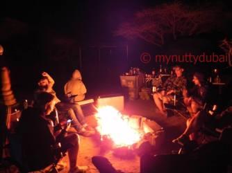 Getting warm around a campfire