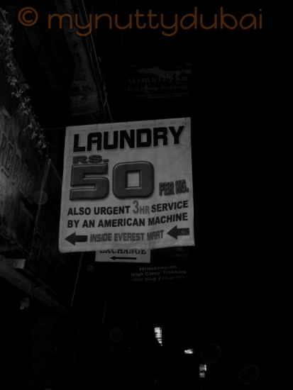 'American machine' - sign outside a laundromat in Nepal