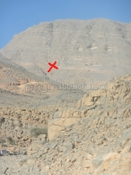 The X indicates part of the hill that is run up on the side of that mountain