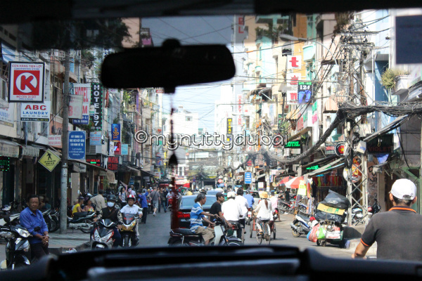 Bicycles, electrical wires, & general street bustle in Ho Chi Minh