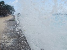 Waves crashing up against the hotel wall